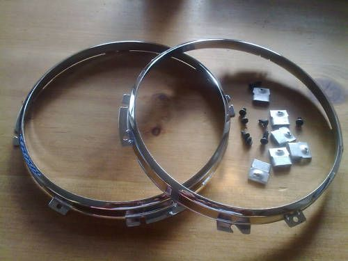 LAND ROVER ALL MODELS NEW CHROME HEADLAMP RETAINERS X 2 (FREE UK POST)