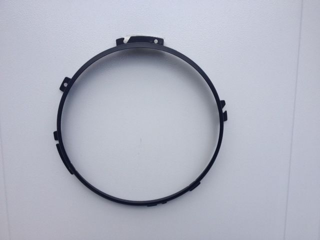 LAND ROVER DEFENDER BLACK UPGRADED HEADLAMP RETAINER.  WON'T RUST LIKE YOURS.